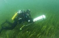 Photo of diver doing underwater survey